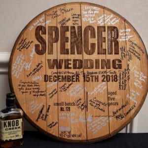 An authentic whiskey barrel heard that your wedding guests will sign as your guest book.