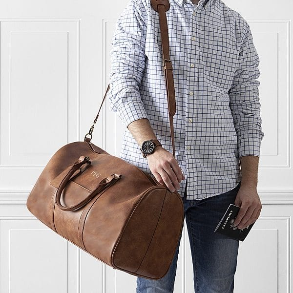Embroider a Vegan Leather Duffle for each of your groomsmen.