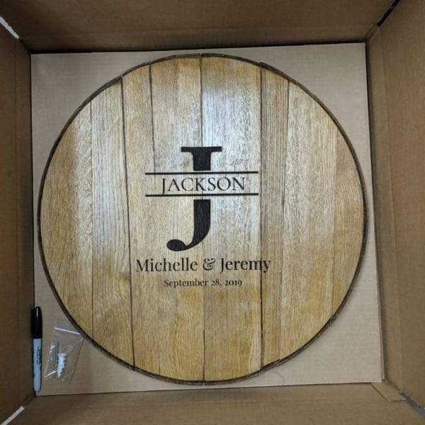 The Big Initial Wedding Barrel Guest Book from WhiskeyMade arrives in a custom package with a sharpie and hanging materials.
