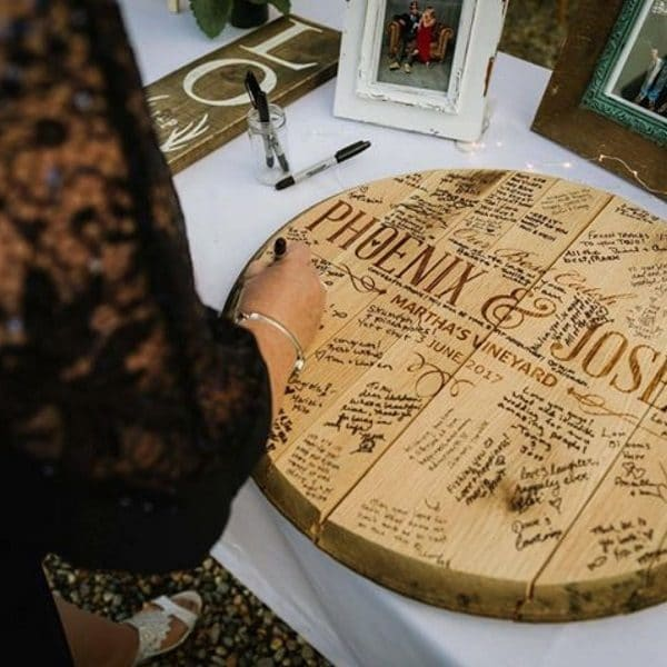 Whiskey guest book on display as guests enter the wedding reception.