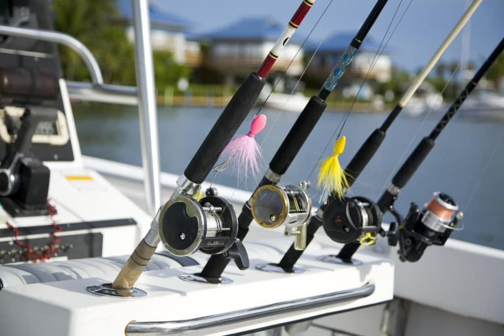 four fishing reels in a boat ready to fish in Islamorada , Florida