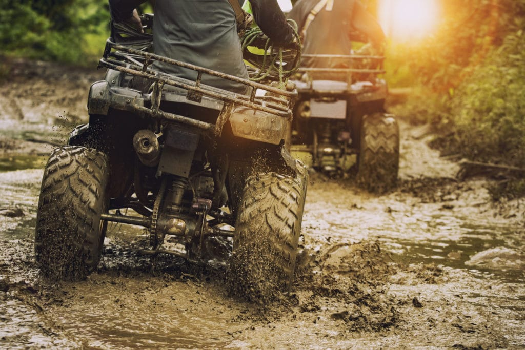 man riding atv vehicle on off road track