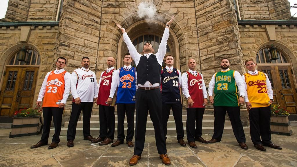 groomsmen all wearing lebron james jerseys as the groom imitates lebron's pre-game ritual