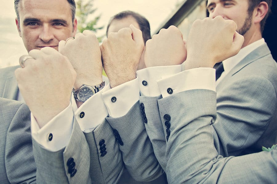groomsmen posing with their new personalized cufflinks