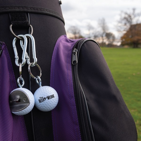 BeerWedges clipped to golf bag using the included carabiner