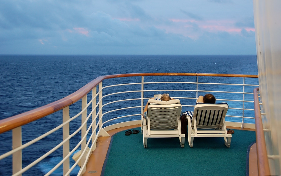 Couple on honeymoon cruise sunbathing