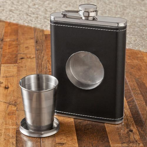 The center portion of the black leather flask pops out and turns into a shot glass for your groomsmen!