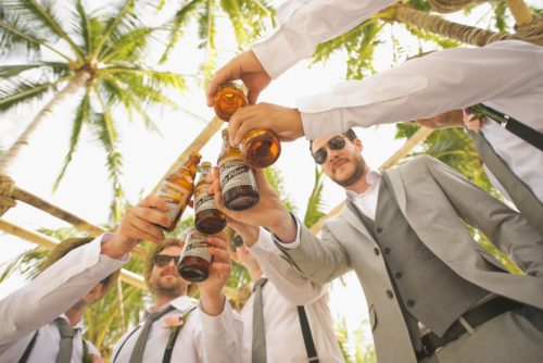 Beach Wedding Groomsmen Drinking Beer
