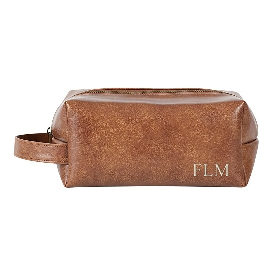 We'll personalize the vegan leather dopp kit with your groomsmen's initials for no extra cost.