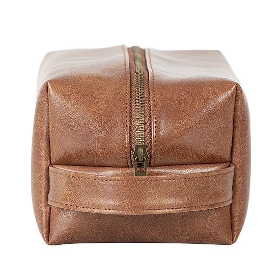 This handsome vegan leather dopp kit will look great on any man's shelf.