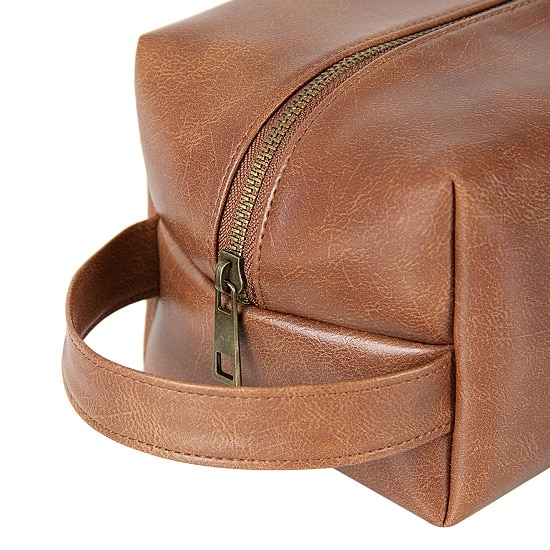 "The handle of the vegan leather dopp kit measures 8""."
