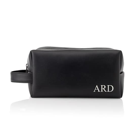 A classic black leather dopp kit for your best man and groomsmen