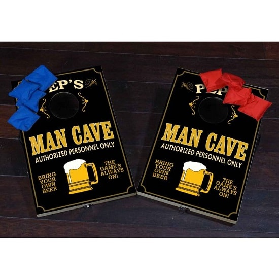 The full man cave cornhole set includes two boards and eight bags.