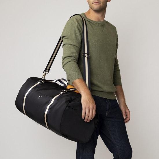Groomsman holding 2536BK Personalized Nylon Black Duffle Bag