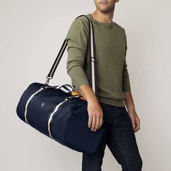 Groomsman holding 2536N Personalized Nylon Navy Duffle Bag