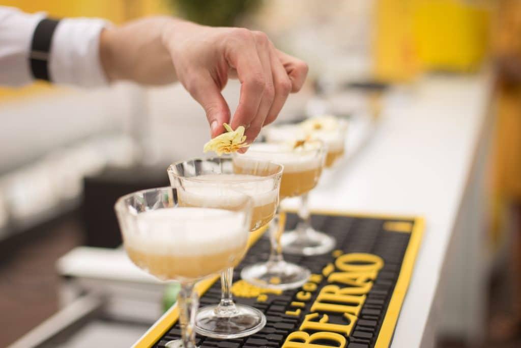 bartender adding garnish to cocktails