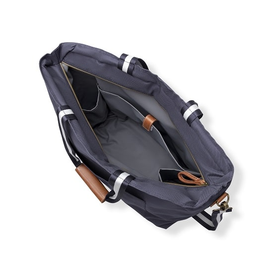 The interior of the bag features three pockets for storing your phone, keys and other valuables.